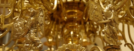 Interior of the Greek Orthodox church. In traditional Greek Orthodox churches, a beautiful circular chandelier with depictions of the saints and apostles, called the horos, hangs beneath the dome.